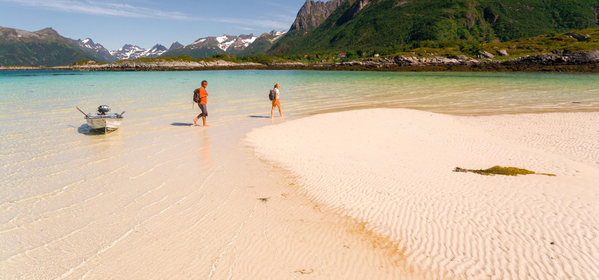 Couple arriving paradise beach in Lofoten